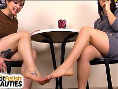 Barefoot lesbians play footises under the table
