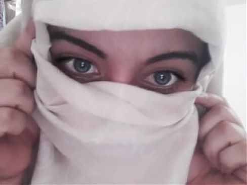 Muslim woman with beautiful blue eyes shows her big breasts